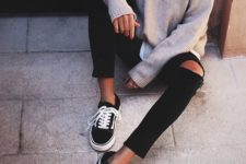 11 distressed black jeans, a neutral sweater and black chucks