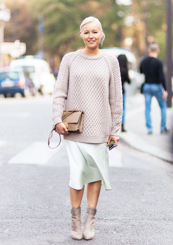 neutral sweater, a mint skirt and ankle boots