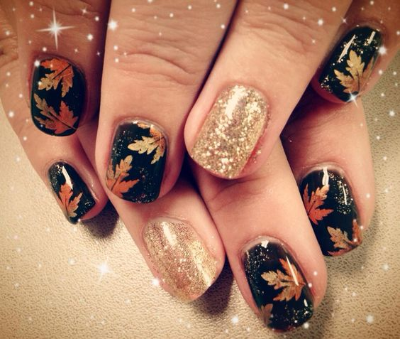 black nails with maple leaves and giltter accents