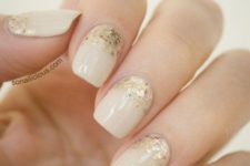 12 ivory nails with gold glitter