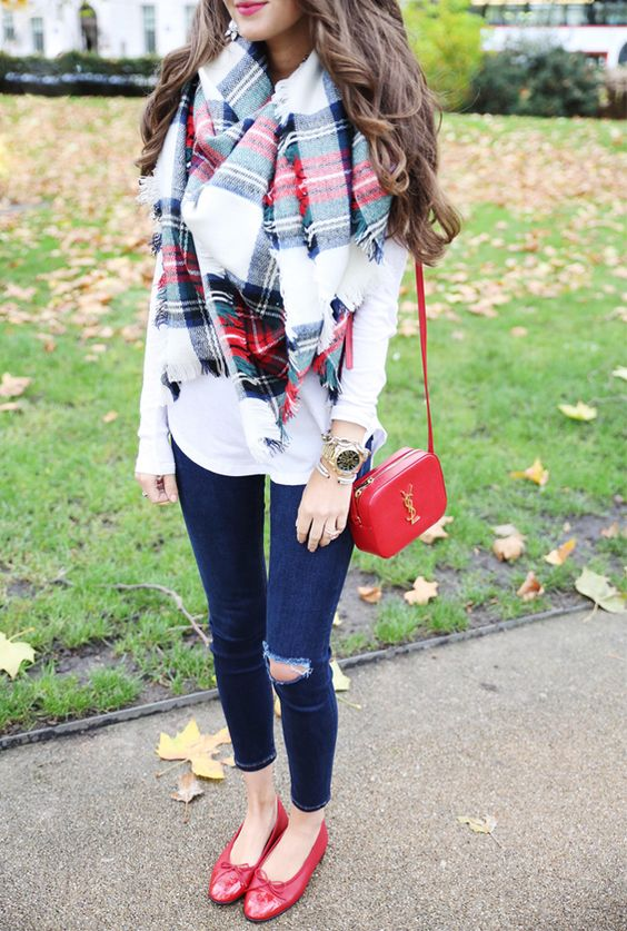ripped jeans, red flats and a crossbody, a white sweater