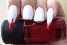 12 white nails with sharp bloody accents