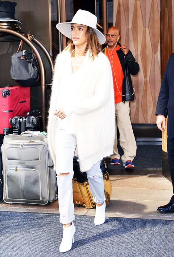 all-white look with jeans,ankle boots, a furry coat and a hat