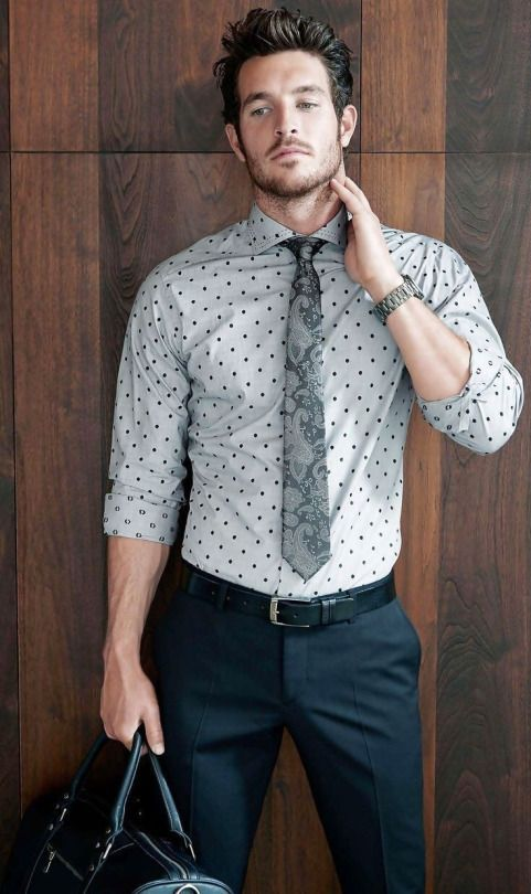 dots and a charcoal paisley neck coupled with navy and black tones