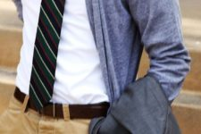 13 dusty blue cardigan, a striped tie and tan pants