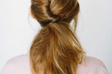 13 low messy ponytail with a twist