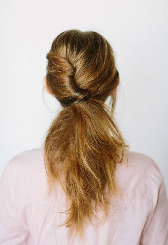 Picture Of Low Messy Ponytail With A Twist