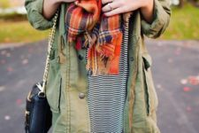 13 striped dress, an army jacket and an orange scarf
