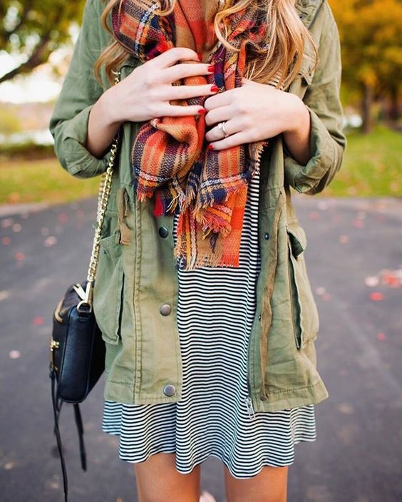 striped dress, an army jacket and an orange scarf