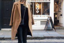 14 black denim, a black sweater, a camel coat and chucks