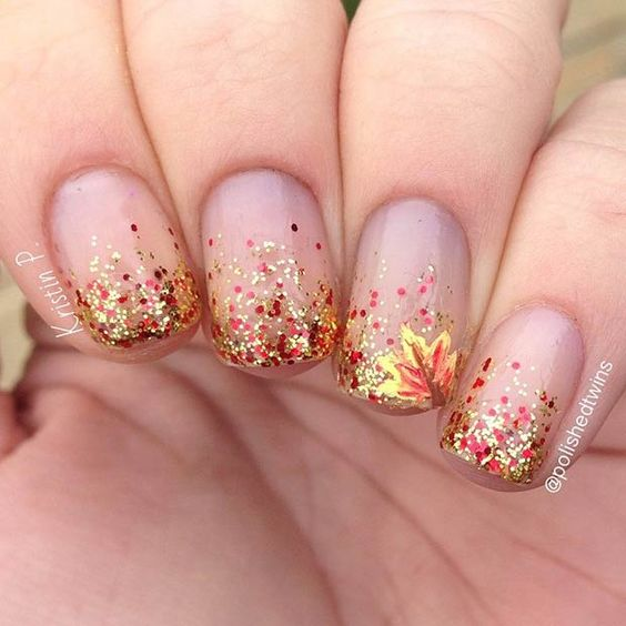 glitter gradient fall nails with a leaf accent