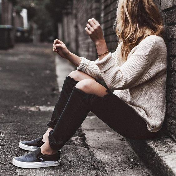 ripped black denim, a nude sweater and black chucks