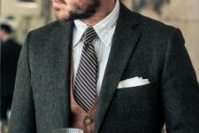 15 a classic tweed jacket, a vest, a shirt and a tie
