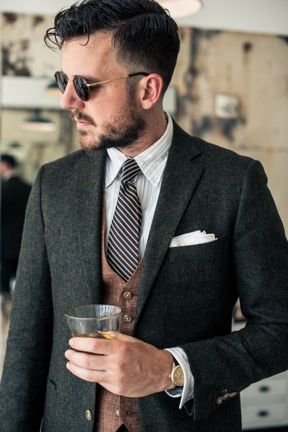 a classic tweed jacket, a vest, a shirt and a tie