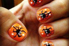 15 bold orange nails with fun spider decals