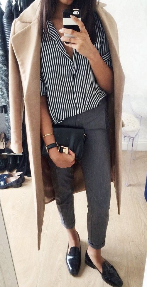 cropped grey pants, a striped shirt, flats and a camel coat