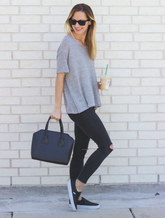 ripped jeans, a grey tee and black sneakers