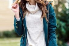 16 distressed denim, a neutral turtleneck and an emerald coat