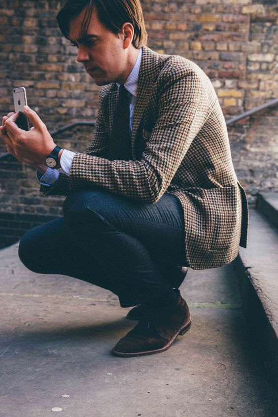 jeans, a tweed blazer and suede brown shoes