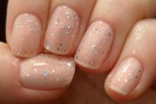 16 nude nails with silver glitter
