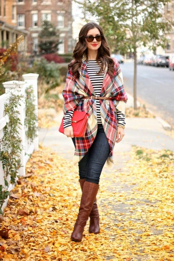 a belted plaid blanket scarf over a striped T shirt, skinny jeans and knee high boots