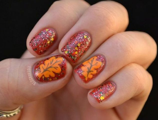 orange and glitter nails with leaves