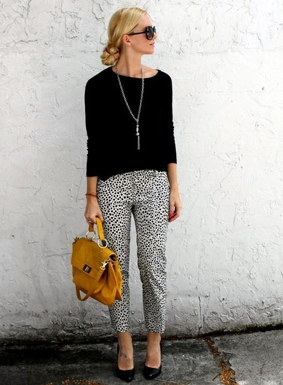 polka dot pants, a black lightweight swetaer and black heels