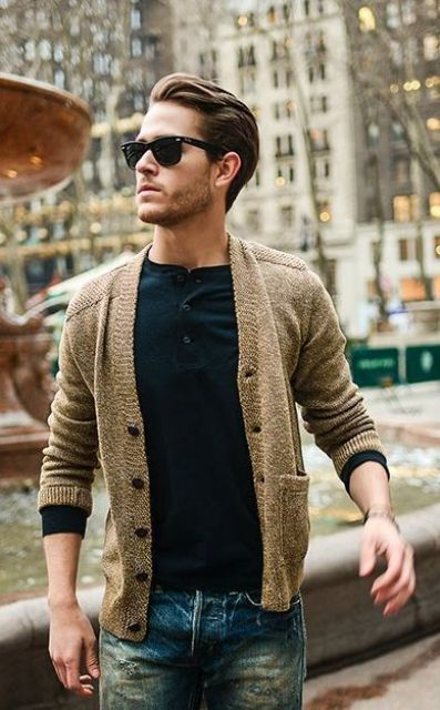 warm tan cardigan, a black tee with buttons and jeans