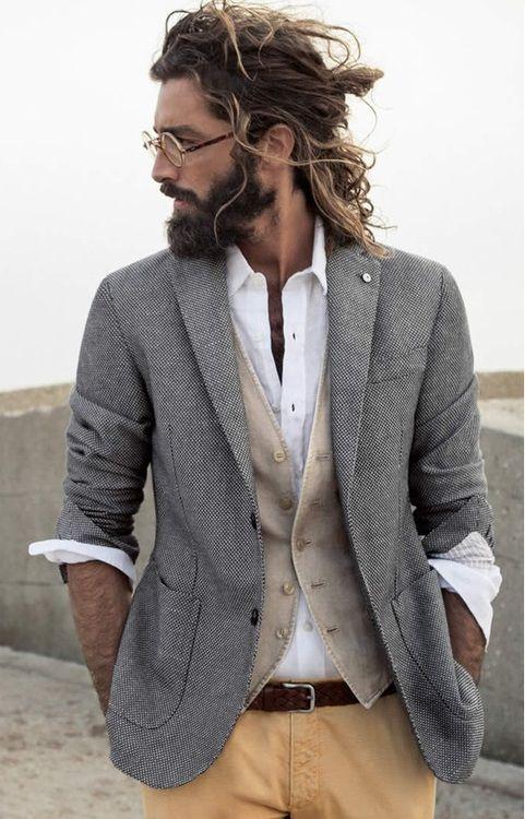 ocher pants, a cream vest and a shirt