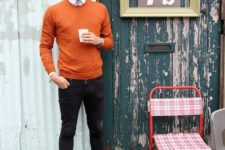 18 orange sweater, a white shirt with a tie and brown shoes