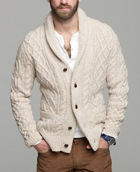 warm knit ivory cardigan, a white shirt and tan trousers