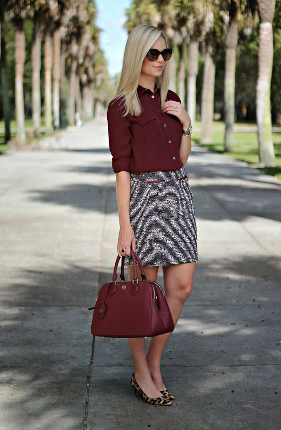 burgundy shirt tucked into a neutral skirt. leopard heels