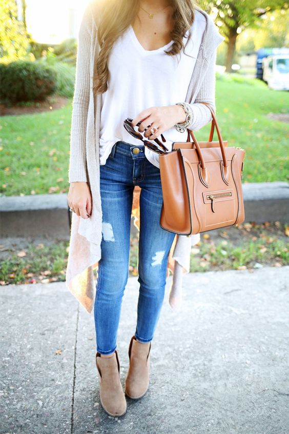 long beige cardigan, blue jeans, a white t-shirt and ankle boots