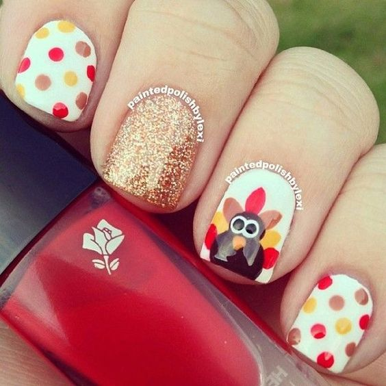 polka dot, glitter nails and an accent nail with a turkey