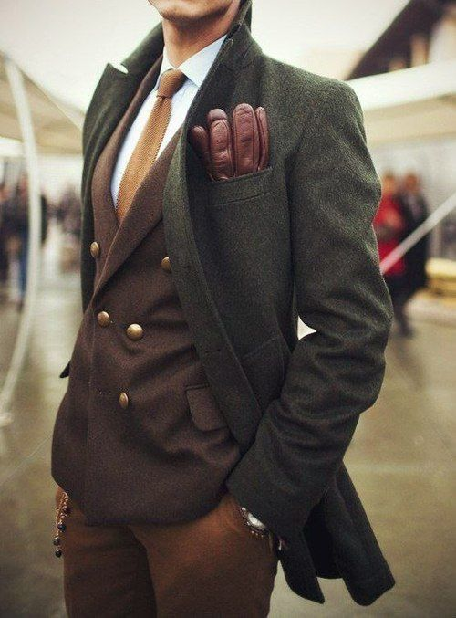 a dark green overcoat to cover a classic suit in fall colors