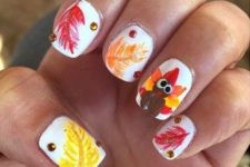 20 leaves and turkey nail design with gems