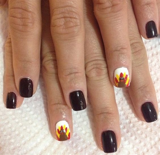 dark brown nails with fun turkey accent nails