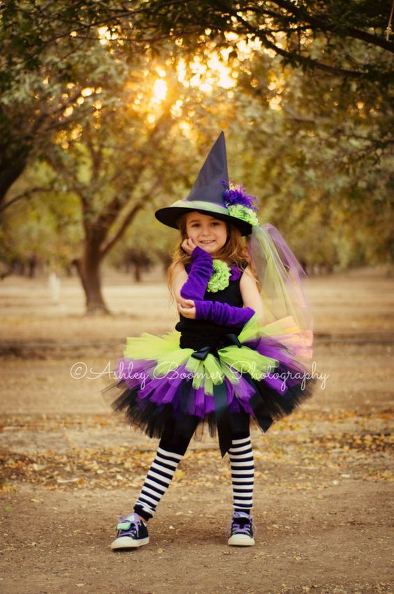 little witch costume with a hat in bold colors