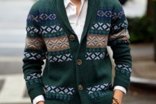 21 patterned green cardigan, brown pants and a white shirt