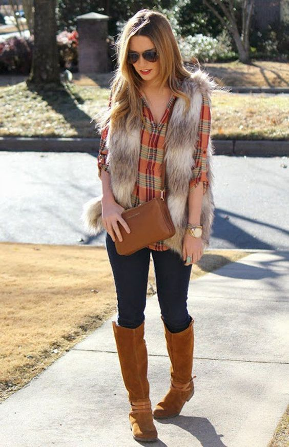 plaid shirt, a fur vest, jeans and suede boots in ocher color