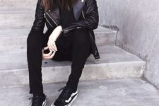 21 rock-style outfit with a black leather jacket and leggings