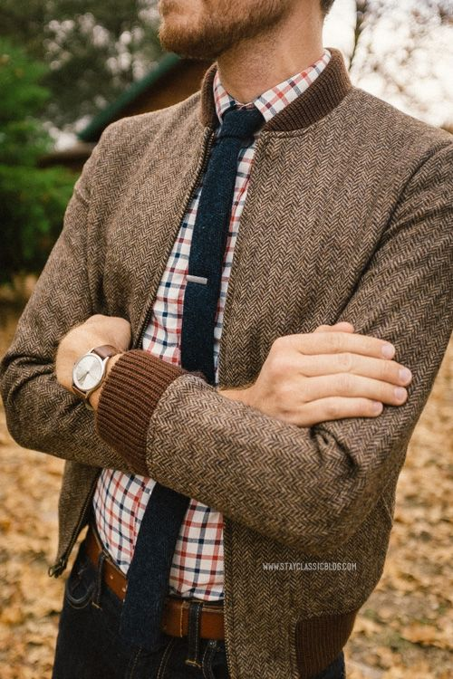 tweed bomber jacket with a plaid shirt and a tie