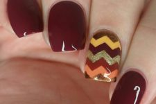 23 burgundy nails with a chevron accent nail