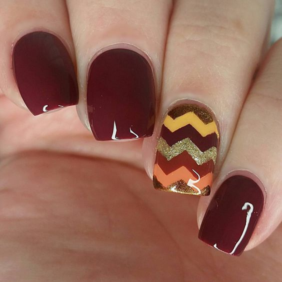 burgundy nails with a chevron accent nail