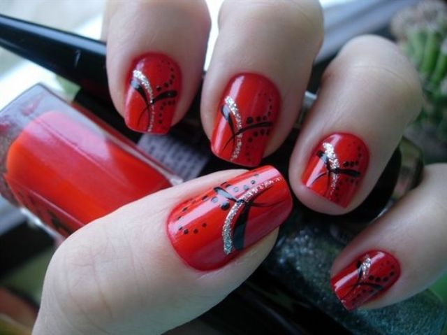 hot red nails with an eye catchy design