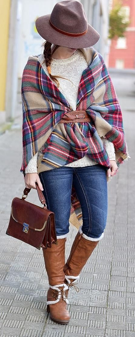 jeans, a white sweater and a plaid scarf belted