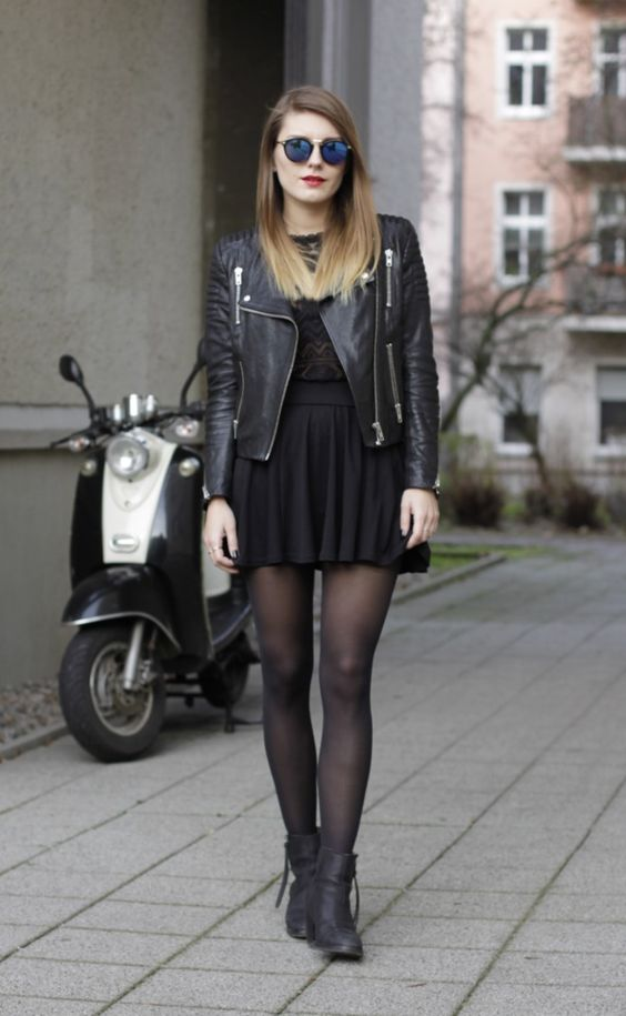 mini dress, a leather jacket and flat ankle boots