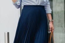 23 pleated midi navy skirt, a striped blue shirt, blush shoes