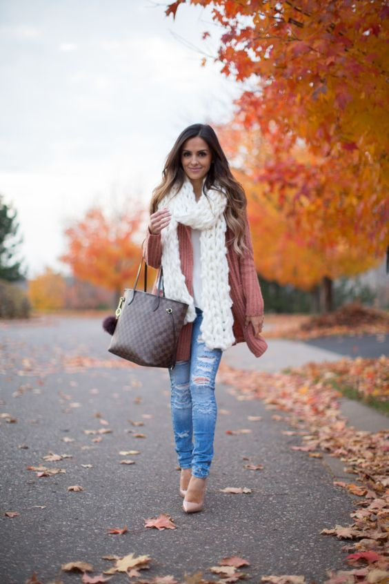 ripped jeans, a pink cardigan, a white scarf and nude shoes
