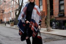 24 all-black outfit with a bold geometric blanket scarf as a shawl